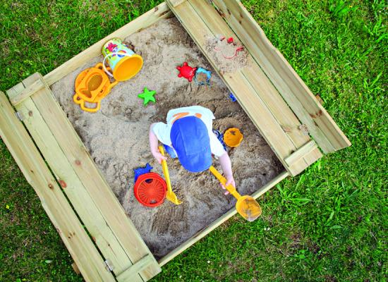 child playing in a sand box