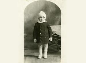 old black and photo of young boy