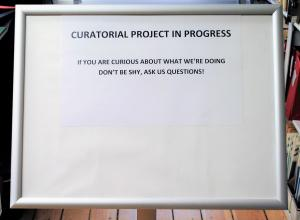 Curatorial Project In Progress Sign